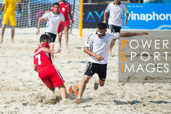 AL ZEIN Moustafa (L) of Afghanistan fights for the ball with YAQOBI Ghulam Reza of Lebanon during the Beach Soccer Men's Team Bronze Medal Match between Lebanon and Afghanistan on Day Nine of the 5th Asian Beach Games 2016 at Bien Dong Park on 02 October 2016, in Danang, Vietnam. Photo by Marcio Machado / Power Sport Images
