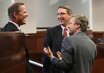 Nevada Senate Republicans, from left, Mark Hutchson, Scott Hammond and Greg Brower talk on the Senate floor at the Legislative Building in Carson City, Nev., on Tuesday, April 16, 2013. .Photo by Cathleen Allison
