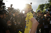 As teammates celebrate around him and press photographers mob the 2015 Tour winner, Chris Froome (GBR/SKY) turnes around and stares backwards just after having crossed the finish line. <br /> Beautiful little moment in a sea of chaos around him.<br /> <br /> stage 21: Sèvres - Champs Elysées (109km)<br /> 2015 Tour de France