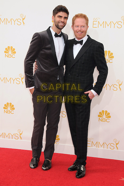 25 August 2014 - Los Angeles, California - Justin Mikita, Jesse Tyler Ferguson. 66th Annual Primetime Emmy Awards - Arrivals held at Nokia Theatre LA Live. <br /> CAP/ADM/BP<br /> &copy;BP/ADM/Capital Pictures