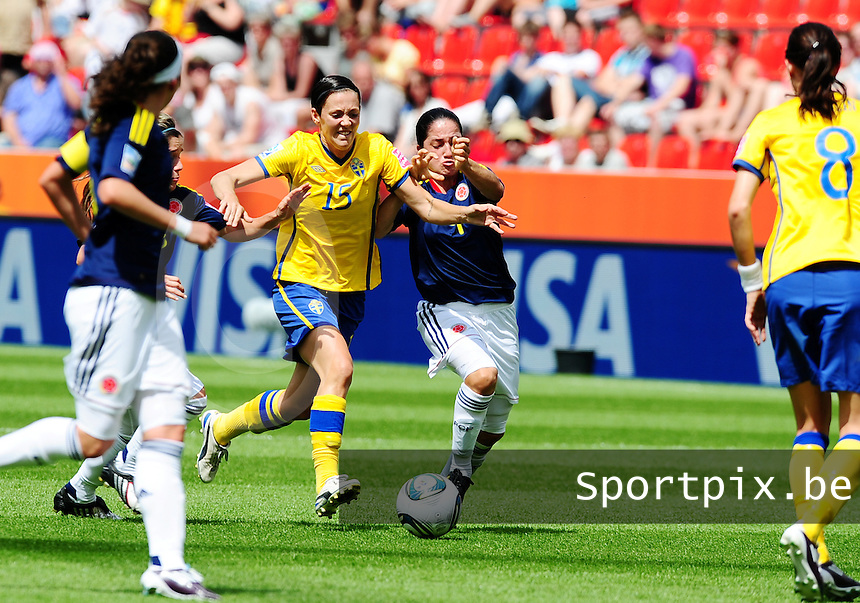 Fifa Women's World Cup Germany 2011 : Colombia - Sweden at Bayarena Leverkusen : Therese Sjogran in duel met Diana Ospina .foto DAVID CATRY / Vrouwenteam.be