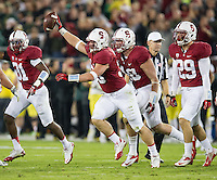 STANFORD, CA - November 7, 2013:  Stanford Cardinal linebacker Jarek Lancaster (35) recovers a fumble during the Stanford Cardinal vs the Oregon Ducks at Stanford Stadium in Stanford, CA. Final score Stanford Cardinal 26, Oregon Ducks  20.