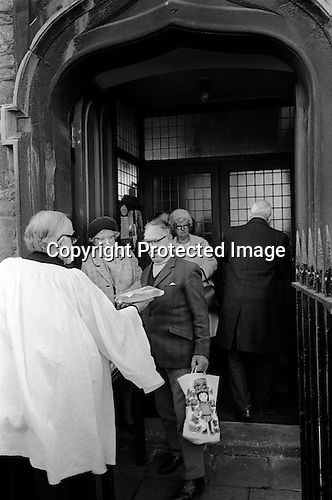 Tuppenny Starvers are large fruit buns distributed every Easter Tuesday.  The Reverend Jones gives out 80 Tuppenny Starvers to children and locals who attend the annual celebration at St Michael on the Mount Without church, St Michaels Hill, Bristol. 1974 The practice was funded from a bequest left for it in 1739.