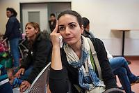 """Die """"Zentrale Aufnahmeeinrichtung des Landes Berlin fuer Asylbewerber"""" (ZAA) des Berliner Landesamt fuer Gesundheit und Soziales (LaGeSo) in der Turmstrasse 21 in Berlin-Moabit. Hier werden alle in Berlin ankommenden Fluechtlinge registriert und bekommen eine Erstversorgung. In dieser Erstaufnahmestelle werden sie auf die vom Land bereitgestellten Unterkuenfte verteilt.<br /> Im Bild: Vida Razavi, Fluechtling aus dem Iran.<br /> 24.9.2014, Berlin<br /> Copyright: Christian-Ditsch.de<br /> [Inhaltsveraendernde Manipulation des Fotos nur nach ausdruecklicher Genehmigung des Fotografen. Vereinbarungen ueber Abtretung von Persoenlichkeitsrechten/Model Release der abgebildeten Person/Personen liegen nicht vor. NO MODEL RELEASE! Don't publish without copyright Christian-Ditsch.de, Veroeffentlichung nur mit Fotografennennung, sowie gegen Honorar, MwSt. und Beleg. Konto: I N G - D i B a, IBAN DE58500105175400192269, BIC INGDDEFFXXX, Kontakt: post@christian-ditsch.de<br /> Urhebervermerk wird gemaess Paragraph 13 UHG verlangt.]"""