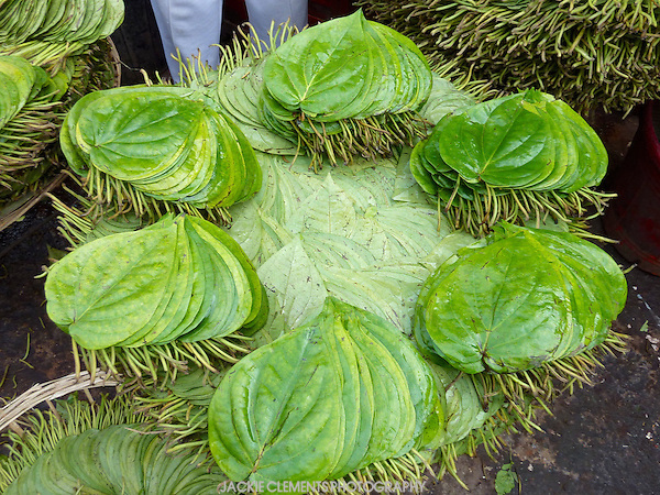 A betel leaf is used to wrap chopped betel nuts and spices, which is then chewed for its euphoric and energising effect. They are displayed in attractive patterns at markets all over Bangladesh.