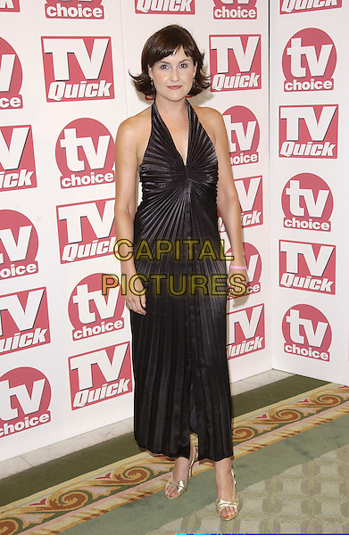ELIZABETH CARLING.Arriving at the TV Quick & TV Choice Awards,.Dorchester Hotel, Park Lane,.full length black halter neck dress pleats gold strappy sandals shoes.London, 5th September 2005.www.capitalpictures.com.sales@capitalpictures.com.© Capital Pictures.