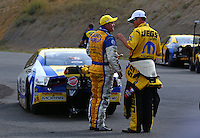 Jul. 20, 2014; Morrison, CO, USA; NHRA pro stock driver Allen Johnson (left) is congratulated by Jeg Coughlin Jr after winning the Mile High Nationals at Bandimere Speedway. Mandatory Credit: Mark J. Rebilas-