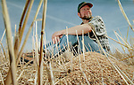 Wainwright, AB farmer Mark Perkins sits amongst the grain stubble on April 20, 2000.  JOHN ULAN/Epic Photography Inc.