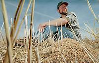 Wainwright, AB farmer Mark Perkins sits amongst the grain stubble on April 20, 2000.  JOHN ULAN/Epic Photography Inc.