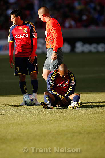 Real Salt Lake midfielder Andy Williams (77) falls to the field after a collision. Real Salt Lake vs. Columbus Crew, MLS Soccer playoffs Saturday, October 31 2009 at Rio Tinto Stadium in Sandy.