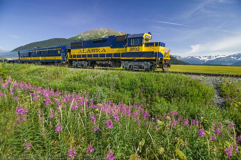 Alaska Railroad passenger train travels along Turnagain Arm, near Anchorage, Alaska