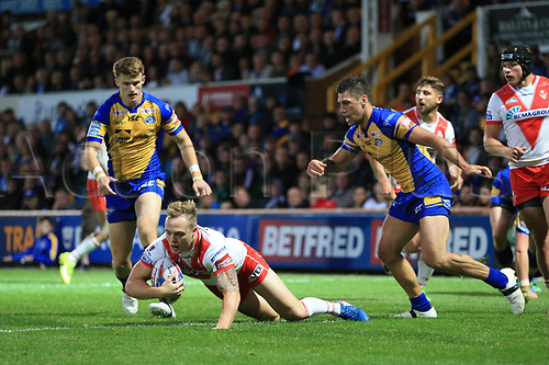 June 29th 2017, Headingley Carnegie, Leeds, England; Betfred Super League; Leeds Rhinos versus St Helens; Joel Moon of Leeds Rhinos brings down Adam Swift of St Helens