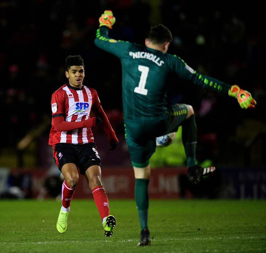 Milton Keynes Dons' Lee Nicholls under pressure from Lincoln City's Tyreece John-Jules<br /> <br /> Photographer Chris Vaughan/CameraSport<br /> <br /> The EFL Sky Bet League One - Lincoln City v Milton Keynes Dons - Tuesday 11th February 2020 - LNER Stadium - Lincoln<br /> <br /> World Copyright © 2020 CameraSport. All rights reserved. 43 Linden Ave. Countesthorpe. Leicester. England. LE8 5PG - Tel: +44 (0) 116 277 4147 - admin@camerasport.com - www.camerasport.com