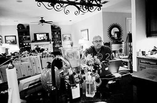 November 7, 2010<br /> Orlando, Florida<br /> <br /> Jeff Dodds organizes the mountain of paperwork associated with his foreclosure, which he has been battling for three years His foreclosure documents were signed by &quot;Robo-signer&quot; Jeffrey Stephan, and GMAC subsequently lost the note on his loan.  He still lives in the home he bought for $880,000.