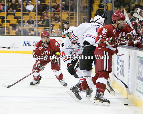 Daniel Moriarty (Harvard - 11), Braden Pimm (Northeastern - 14), Garrett Vermeersch (Northeastern - 9), Brendan Rempel (Harvard - 42) - The Northeastern University Huskies defeated the Harvard University Crimson 4-0 in their Beanpot opener on Monday, February 7, 2011, at TD Garden in Boston, Massachusetts.