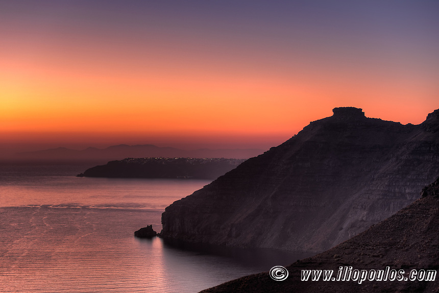 The famous skaros at sunset in Santorini, Greece