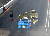 Feb 24, 2019; Chandler, AZ, USA; NHRA funny car driver Tommy Johnson Jr loses a rear tire after an axle failure and explosion during the Arizona Nationals at Wild Horse Pass Motorsports Park. Johnson was uninjured. Mandatory Credit: Mark J. Rebilas-USA TODAY Sports