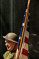 A man dressed in historic military attire waits during Charlotte's 13th annual St. Patrick's Day Parade 2009. Thousands of people turned out to watch the annual St. Patrick's Day Parade in Uptown/Downtown Charlotte, North Carolina.  (Model Released)