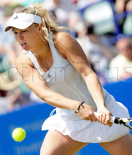 "Danish Caroline Wozniacki returns a ball to French Aravane Rezai  during their womens singles first round match in the AEGON International tennis tournament in Eastbourne, Britain, 15 June 2010. The AEGON International is a tennis tournament on the Women's Tennis Association Tour and the ATP World Tour that is taking place from 12 to 19 June 2010 .The tournament is played on outdoor grass courts, and is generally considered a ""warm-up"" for the Wimbledon Grand Slam event, which begins the following week."