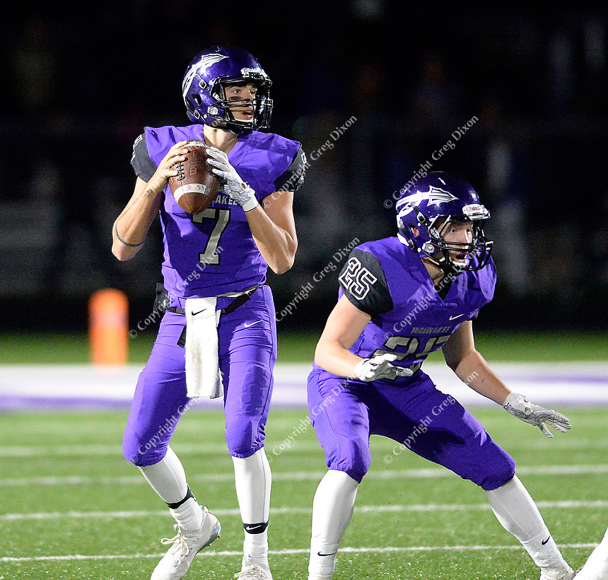 Waunakee quarterback, Jarrett Wulf drops back to pass behind the protection of Evan Zwettler, as Reedsburg takes on Waunakee in Wisconsin Badger North Conference high school football at Waunakee High School on Friday, 9/28/18