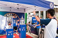 A Chelsea FC fan poses for a photo with the Champions League Trophy and FA Cup prior to the match between Chelsea FC and Paris Saint-Germain during the 2012 Herbalife World Football Challenge at Yankee Stadium in New York, NY, on July 22, 2012.