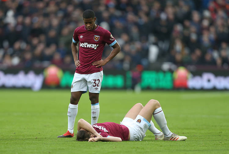 West Ham United's Xande Silva looks over the injured Andy Carroll<br /> <br /> Photographer Rob Newell/CameraSport<br /> <br /> Emirates FA Cup Third Round - West Ham United v Birmingham City - Saturday 5th January 2019 - London Stadium - London<br />  <br /> World Copyright &copy; 2019 CameraSport. All rights reserved. 43 Linden Ave. Countesthorpe. Leicester. England. LE8 5PG - Tel: +44 (0) 116 277 4147 - admin@camerasport.com - www.camerasport.com