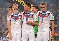 FUSSBALL WM 2014                       FINALE   Deutschland - Argentinien     13.07.2014 DEUTSCHLAND FEIERT DEN WM TITEL: Andre Schuerrle, Julian Draxler und Matthias Ginter (v.l.) geniessen den Moment
