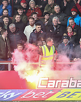 A steward removes a flare as Fleetwood Town fans enjoy the pre-match atmosphere <br /> Photographer Lee Parker/CameraSport<br /> <br /> The EFL Sky Bet League One - Fleetwood Town v Blackpool - Saturday 7th March 2020 - Highbury Stadium - Fleetwood<br /> <br /> World Copyright © 2020 CameraSport. All rights reserved. 43 Linden Ave. Countesthorpe. Leicester. England. LE8 5PG - Tel: +44 (0) 116 277 4147 - admin@camerasport.com - www.camerasport.com