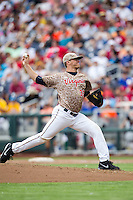 Virginia Cavaliers pitcher Connor Jones (33) delivers a pitch to the plate against the Arkansas Razorbacks in Game 1 of the NCAA College World Series on June 13, 2015 at TD Ameritrade Park in Omaha, Nebraska. Virginia defeated Arkansas 5-3. (Andrew Woolley/Four Seam Images)