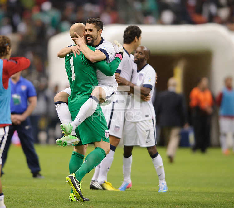 Mexico City, Mexico -Tuesday, March 26 2013: USA ties Mexico 0-0 during World Cup Qualifying at Estadio Azteca. Brad Guzan  and Hercules Gomez celebrate after the match.