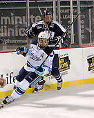 Spencer Abbott (Maine - 13), Connor Hardowa (UNH - 2) - The University of Maine Black Bears defeated the University of New Hampshire Wildcats 5-4 in overtime on Saturday, January 7, 2012, at Fenway Park in Boston, Massachusetts.