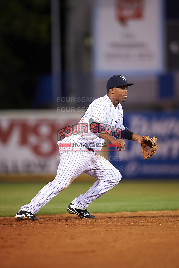 Tampa Yankees shortstop Abiatal Avelino (22) fields a ground ball during a game against the Bradenton Marauders on April 11, 2016 at George M. Steinbrenner Field in Tampa, Florida.  Tampa defeated Bradenton 5-2.  (Mike Janes/Four Seam Images)