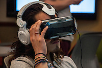Logan Justice tries out the Oculus Rift virtual reality headset on February 15, 2016 in Brown Lab. Event organized by student Drake Tien. As part of UN week, students watch selected short films about a young Syrian refugee or the Ebola virus aftermathin Liberia. (Photo by Nick Harrington, Occidental College Class of 2017)