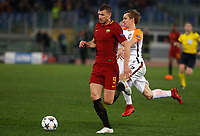 Roma s Edin Dzeko, left, is chased by Shakhtar Donetsk's Bohdan Butko during the Uefa Champions League round of 16 second leg soccer match between Roma and Shakhtar Donetsk at Rome's Olympic stadium, March 13, 2018. Roma won. 1-0 to join the quarter finals.<br /> UPDATE IMAGES PRESS/Riccardo De Luca