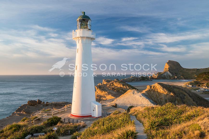 Dawn, Castlepoint lighthouse, looking towards Castle Rock, Wairarapa, New Zealand - stock photo, canvas, fine art print