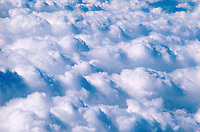 Aerial view of a wide bank of fluffy white clouds.