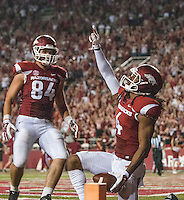 STAFF PHOTO ANTHONY REYES &bull; @NWATONYR<br /> Keon Hatcher Arkansas wide receiver, celebrates a fourth quarter touchdown against Northern Illinois University Saturday, Sept. 20, 2014 at Razorback Stadium in Fayetteville. The Razorbacks won 52-14.