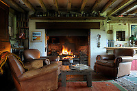 At one end of the barn is a cosy sitting room, its low ceiling created when the upstairs floor was built 11 years ago