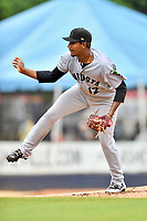 Augusta GreenJackets starting pitcher Jose Marte (12) delivers a pitch during a game against the Asheville Tourists at McCormick Field on August 19, 2018 in Asheville, North Carolina. The Tourists defeated the GreenJackets 6-3. (Tony Farlow/Four Seam Images)