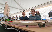 "(L-R) Zhengyang Chu with his advisor Mariusz Bojarski display a wireless powered train at the NYU-Polytechnic School of Engineering""s second annual Research Expo in Brooklyn's ""Tech Triangle"" in New York on Friday, May 2, 2014. Over forty research projects and their creators will exhibit and explain their research including cutting-edge robotics, engineering and biotechnology.  (© Richard B. Levine)"