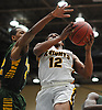Danny Ashley #12 of Uniondale, right, drives to the net as Tyreik Frazier #42 of Westbury contests his shot during the Nassau County varsity boys basketball Class AA semifinals at Farmingdale State College on Monday, Feb. 26, 2018. Ashley scored 15 points in top-seeded Uniondale's 61-44 win.