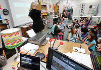 NWA Democrat-Gazette/DAVID GOTTSCHALK  Shelle (cq) Stormoe, education coordinator for the Arkansas Historic Preservation Program gives a presentation about the ghost stories and folklore associated with historic Arkansas buildings and sites ednesday, September 9, 2015 in the gifted and talented class of Jenny Jones at Helen Tyson Middle School in Springdale.