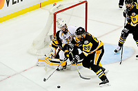 May 29, 2017: Nashville Predators center Colton Sissons (10) battles Pittsburgh Penguins defenseman Ian Cole (28) for control of the puck in front of goalie Matt Murray (30)  during game one of the National Hockey League Stanley Cup Finals between the Nashville Predators  and the Pittsburgh Penguins, held at PPG Paints Arena, in Pittsburgh, PA. Pittsburgh defeats Nashville 5-3 in regulation time.  Eric Canha/CSM