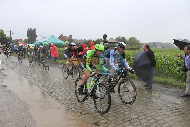 Riders including Bram Tankink (NED) Belkin and Jens Voigt (GER) Trek Factory Racing tackle the1st cobbled sector 9 from Gruson to Crossroads de l'Arbe during Stage 5 of the 2014 Tour de France running 155.5km from Ypres to Arenberg. 9th July 2014.<br /> Picture: Eoin Clarke www.newsfile.ie
