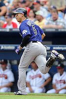 Colorado Rockies left fielder Carlos Gonzalez #5 runs to first during a game against the Atlanta Braves at Turner Field on September 3, 2012 in Atlanta, Georgia. The Braves  defeated the Rockies 6-1. (Tony Farlow/Four Seam Images).
