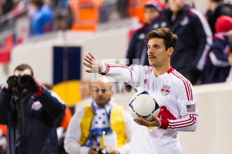 Heath Pearce (3) of the New York Red Bulls on a throw in. D. C. United defeated the New York Red Bulls 1-0 (2-1 in aggregate) during the second leg of the MLS Eastern Conference Semifinals at Red Bull Arena in Harrison, NJ, on November 8, 2012.