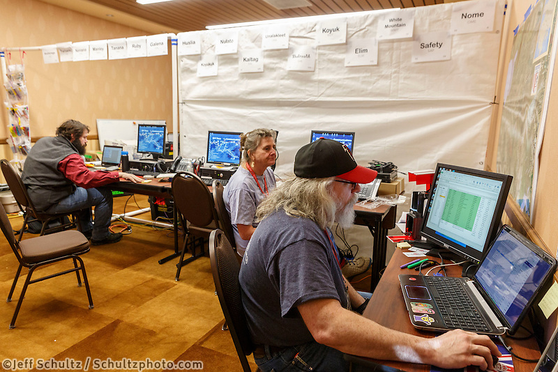 Race Comms volunteers Bryan Nelson, Patty Montague and Reece J. Roberts configure checkpoint computers at the race headquarters at the Lakefront Anchorage hotel on Thursday March 2, 2017 two days prior to Iditarod 2017.<br /> <br /> Photo by Jeff Schultz/SchultzPhoto.com  (C) 2017  ALL RIGHTS RESVERVED