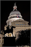 In Austin, Texas, the seat of the state government, this photograph shows the Texas Ranger Monument at night.