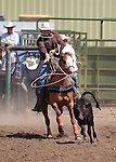 A member of the Last Minute Cattle team competes in the calf roping event at the Minden Ranch Rodeo in Gardnerville, Nev., on Sunday, July 22, 2012..Photo by Cathleen Allison
