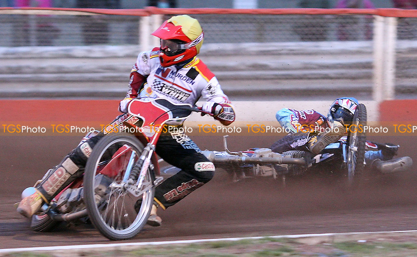 Heat 11: Paul Hurry (yellow) takes out Phil Morris (blue) - Lakeside Hammers vs Swindon Robins, KO Cup Semi-Final 2nd Leg at the Arena Essex Raceway, Purfleet - 12/06/09 - MANDATORY CREDIT: Rob Newell/TGSPHOTO - Self billing applies where appropriate - 0845 094 6026 - contact@tgsphoto.co.uk - NO UNPAID USE.